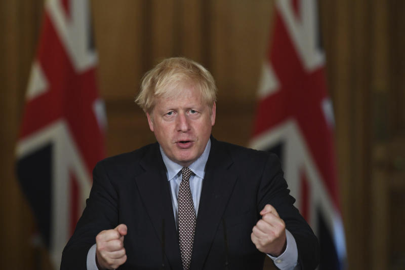 Britain's Prime Minister Boris Johnson speaks during a virtual press conference at Downing Street, London, Wednesday Sept. 9, 2020, following the announcement that the legal limit on social gatherings is set to be reduced from 30 people to six. The change in England will come into force on Monday as the Government seeks to curb the rise in coronavirus cases. (Stefan Rousseau/Pool via AP)