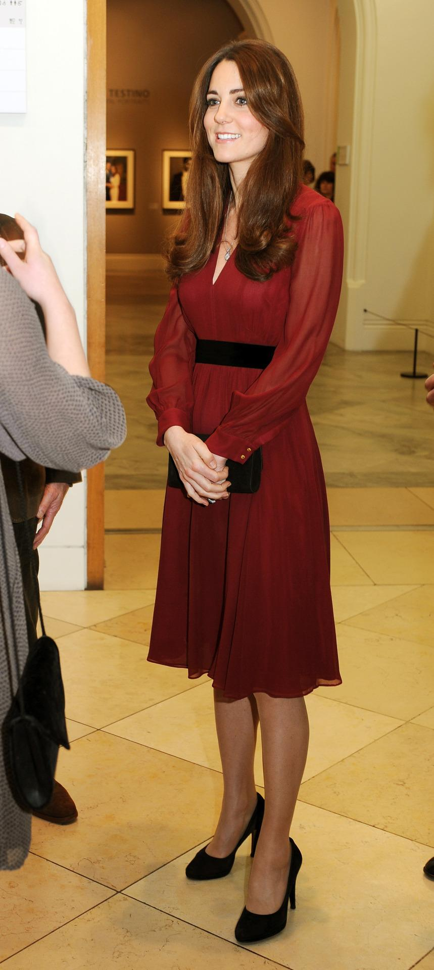 <p>The Duchess wore a red silk dress from high street retailer Whistles to view a portrait of herself at the National Portrait Gallery. She accessorised with black suede heels by Episode and a pendant necklace by Asprey. </p><p><i>[Photo: PA]</i></p>