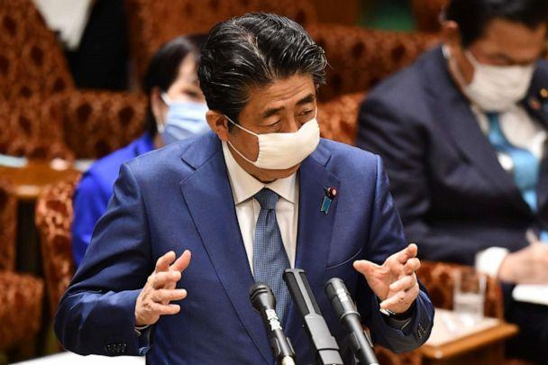 PHOTO: Japanese Prime Minister Shinzo Abe wears a face mask while answering questions during an upper house budget committee session at the parliament in Tokyo on April 30, 2020. (Kazuhiro Nogi/AFP via Getty Images)