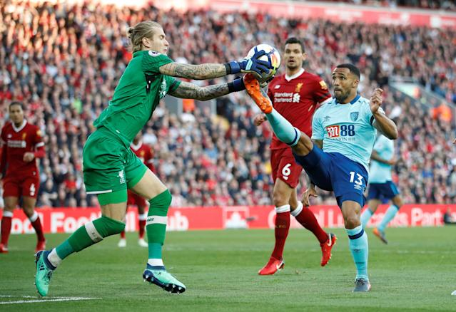 "Soccer Football - Premier League - Liverpool vs AFC Bournemouth - Anfield, Liverpool, Britain - April 14, 2018 Liverpool's Loris Karius in action with Bournemouth's Callum Wilson Action Images via Reuters/Carl Recine EDITORIAL USE ONLY. No use with unauthorized audio, video, data, fixture lists, club/league logos or ""live"" services. Online in-match use limited to 75 images, no video emulation. No use in betting, games or single club/league/player publications. Please contact your account representative for further details."