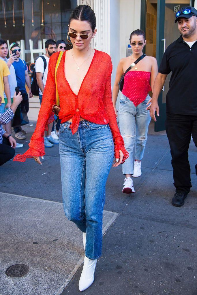 <p>Kendall steps out in a see-through orange shirt in New York, July 2017 </p>