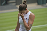 Czech Republic's Karolina Pliskova reacts after losing a point to Australia's Ashleigh Barty during the women's singles final match on day twelve of the Wimbledon Tennis Championships in London, Saturday, July 10, 2021. (AP Photo/Alberto Pezzali)