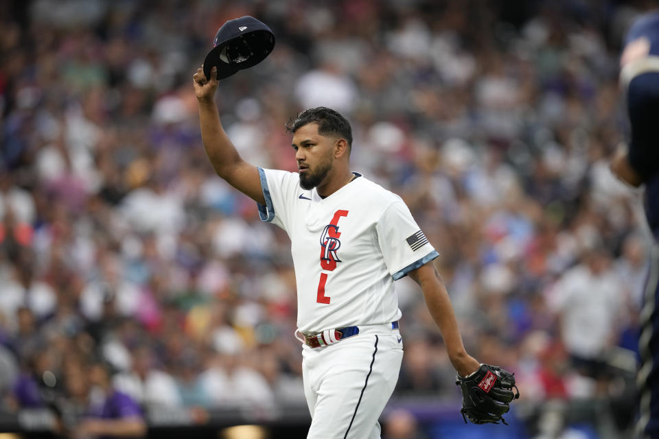 National League's German Marquez, of the Colorado Rockies, tips his cap to the home crowd after pitching during the fourth inning of the MLB All-Star baseball game, Tuesday, July 13, 2021, in Denver. (AP Photo/David Zalubowski)