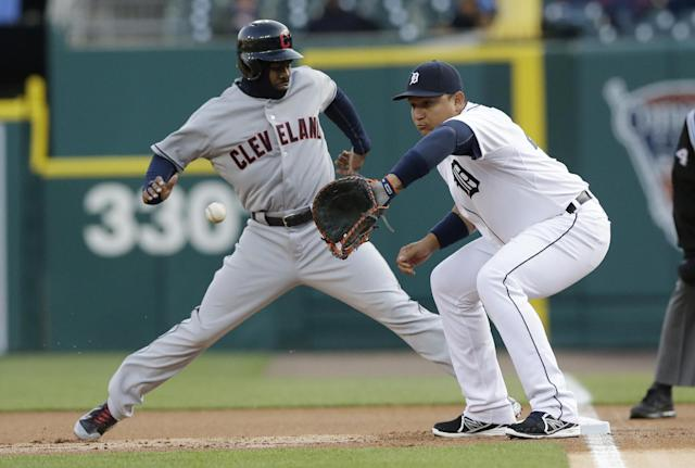 Cleveland Indians' Michael Bourn jumps back to first at Detroit Tigers first baseman Miguel Cabrera waits on the throw from starting pitcher Anibal Sanchez during the first inning of a baseball game in Detroit, Wednesday, April 16, 2014. (AP Photo/Carlos Osorio)