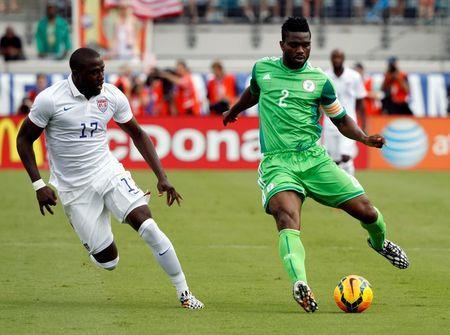 Nigeria defender Joseph Yobo (2) passes the ball as United States forward Jozy Altidore (17) defends during the first half at EverBank Field. Mandatory Credit: Kim Klement-USA TODAY Sports