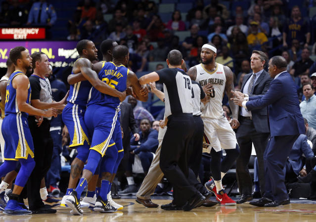 "<a class=""link rapid-noclick-resp"" href=""/nba/players/4244/"" data-ylk=""slk:Kevin Durant"">Kevin Durant</a> gets ""held back"" by teammates and earns an ejection. (AP Photo/Gerald Herbert)"
