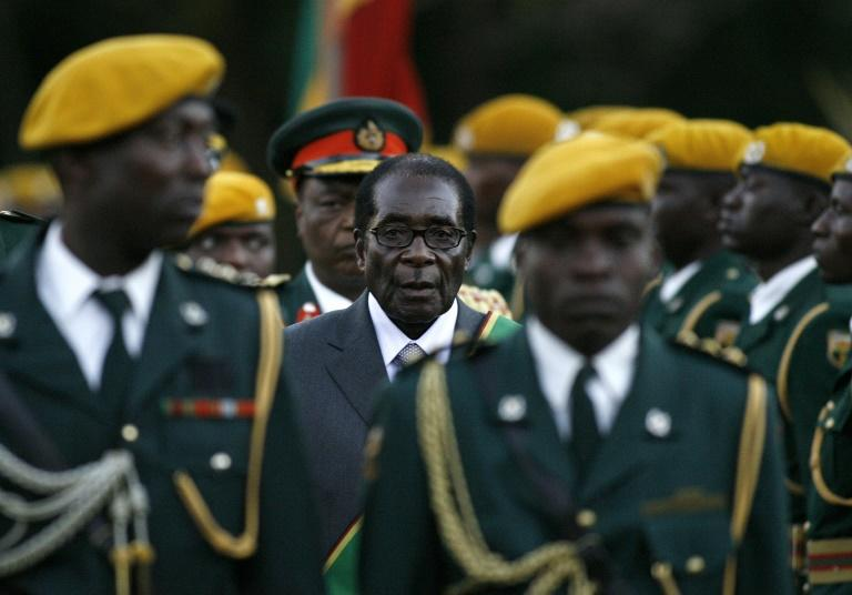 Zimbabwean President Robert Mugabe was left a 'broken soul' when the army turned against him in 2017 (AFP Photo/ALEXANDER JOE)