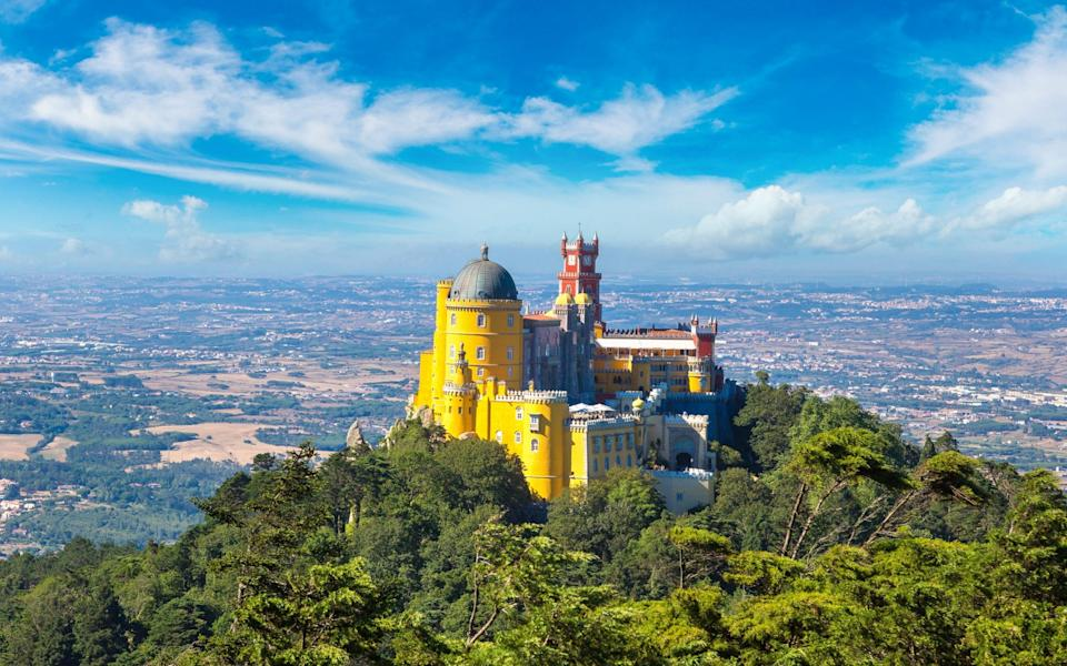 Panoramic view of Pena National Palace in Sintra on a beautiful summer day - S-F/Shutterstock