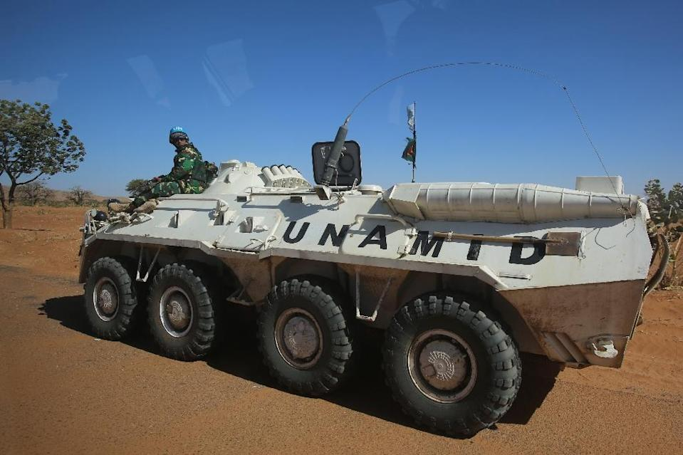 A member of the UN-African Union mission in Darfur sits on an armoured personnel carrier patrolling near the city of Nyala, January 12, 2015 in Sudan (AFP Photo/Ashraf Shazly)