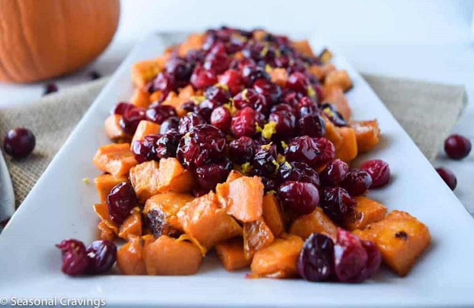 """<p>Adding color to your Thanksgiving table is easy with these roasted maple sweet potatoes. Served with cranberries and seasoned to perfection, this easy recipe takes <a href=""""https://www.thedailymeal.com/easy-dishes-one-hour?referrer=yahoo&category=beauty_food&include_utm=1&utm_medium=referral&utm_source=yahoo&utm_campaign=feed"""" rel=""""nofollow noopener"""" target=""""_blank"""" data-ylk=""""slk:less than one hour to make"""" class=""""link rapid-noclick-resp"""">less than one hour to make</a>.</p> <p><a href=""""https://www.thedailymeal.com/recipes/roasted-maple-sweet-potatoes-and-cranberries-recipe?referrer=yahoo&category=beauty_food&include_utm=1&utm_medium=referral&utm_source=yahoo&utm_campaign=feed"""" rel=""""nofollow noopener"""" target=""""_blank"""" data-ylk=""""slk:For the Roasted Maple Sweet Potatoes and Cranberries recipe, click here."""" class=""""link rapid-noclick-resp"""">For the Roasted Maple Sweet Potatoes and Cranberries recipe, click here.</a></p>"""