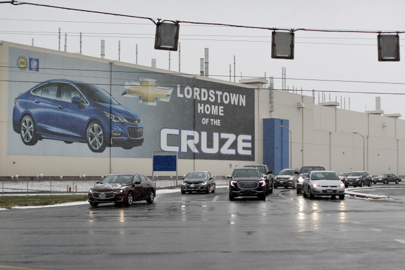 FILE - In this Nov. 27, 2018, file photo a banner depicting the Chevrolet Cruze model vehicle is displayed at the General Motors' Lordstown plant in Lordstown, Ohio. An economic renaissance in the industrial Midwest promised by President Donald Trump has suffered in recent weeks in ways that could be problematic for Trump's 2020 re-election. (AP Photo/John Minchillo, File)