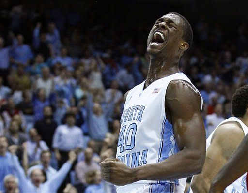 North Carolina's Harrison Barnes reacts following a dunk against North Carolina State during the first half of an NCAA college basketball game in Chapel Hill, N.C., Thursday, Jan. 26, 2012. (AP Photo/Gerry Broome)