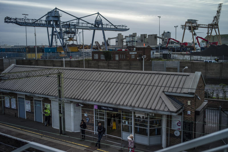 TILBURY, ENGLAND - OCTOBER 28: Passengers wait for a train at Tilbury Town Station next to Tilbury Docks near Purfleet on October 28, 2019 in Tilbury, England. Purfleet port was the arrival point for a lorry trailer with 39 smuggled migrants, all of whom were found dead early on October 23 in the nearby town of Grays. (Photo by Dan Kitwood/Getty Images)