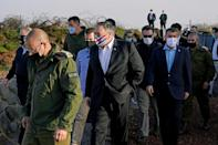 US Secretary of State Mike Pompeo and Israeli Foreign Minister Gabi Ashkenazi arrive for a security briefing in the Israeli-annexed Golan Heights, in a first visit by a top US diplomat, on November 19, 2020