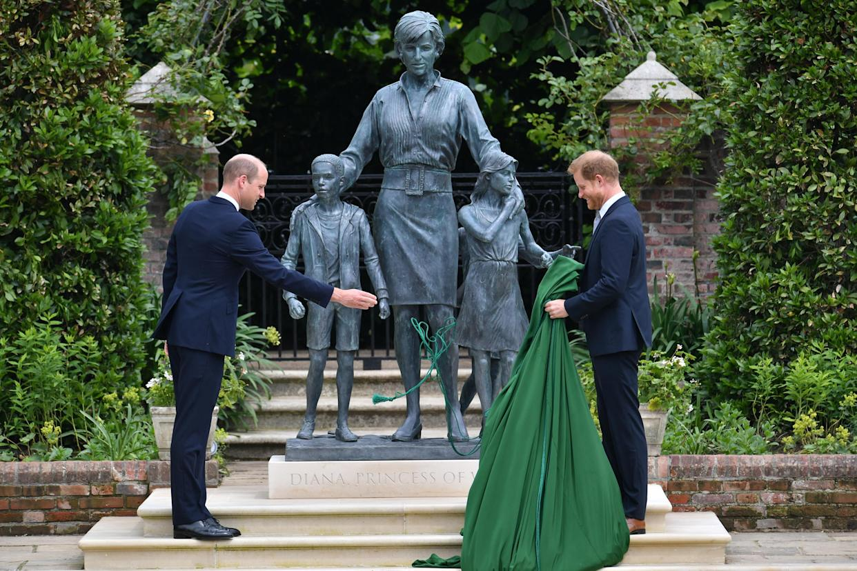 The Duke of Cambridge (left) and Duke of Sussex unveiling a statue they commissioned of their mother Diana, Princess of Wales, in the Sunken Garden at Kensington Palace, London, on what would have been her 60th birthday. Picture date: Thursday July 1, 2021.