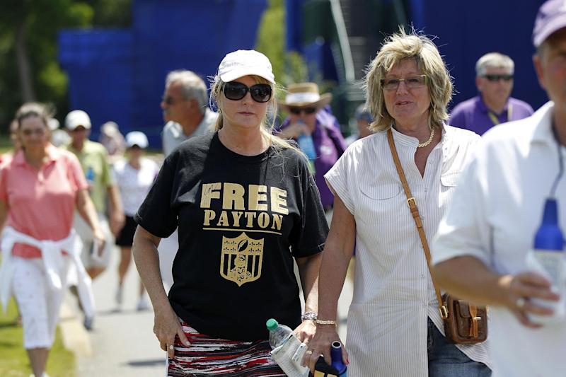 A person in the crowd wears a T-shirt referencing suspended New Orleans Saints NFL football head coach Sean Payton as Payton plays in the Pro-Am rounds of the PGA golf Zurich Classic at TPC Louisiana in Avondale, La., Wednesday, April 25, 2012. (AP Photo/Gerald Herbert)
