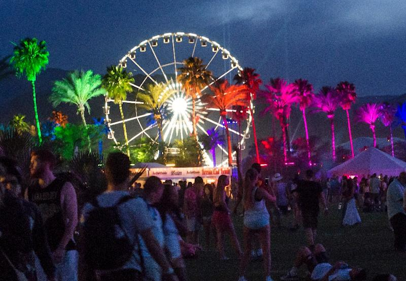 Colored lights illuminate palm trees on the first day of the Coachella Music Festival, in Indio, California, April 10, 2015 (AFP Photo/Robyn Beck)