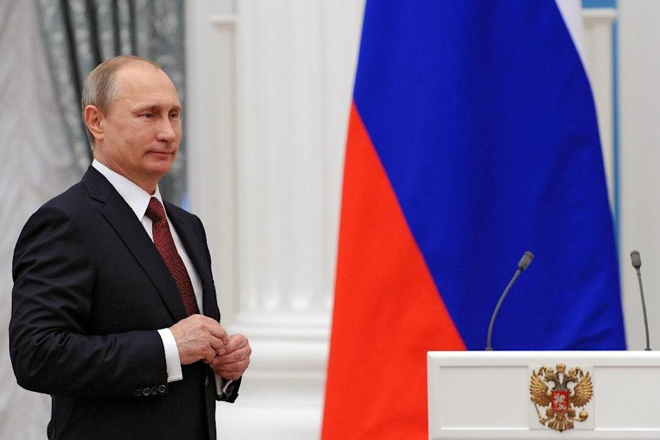 Russian President Vladimir Putin, pictured in Moscow on May 1, 2015, ratified an accord to set up a $100-billion reserve fund for the so-called BRICS (AFP Photo/Mikhail Klimentyev)