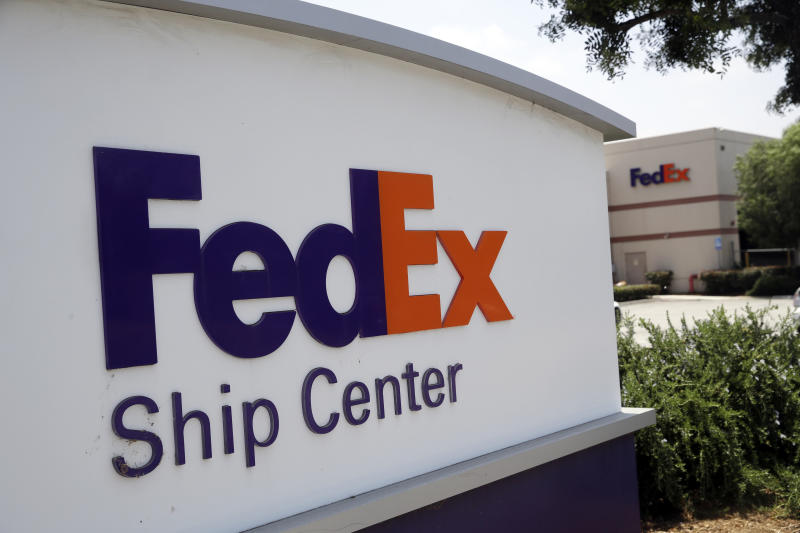 This Monday, June 24, 2019, photo shows an exterior view of a FedEx Ship Center in Los Angeles. FedEx is suing the United States government over export rules it says are virtually impossible to follow because it handles millions of packages a day. (AP Photo/Marcio Jose Sanchez)