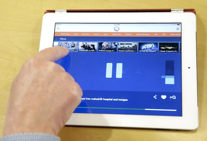 In this Friday, Feb. 21, 2014, photo, Mike Ramsay, CEO of Qplay, gives a demonstration of Qplay on a tablet device in San Francisco. (AP Photo/Jeff Chiu)