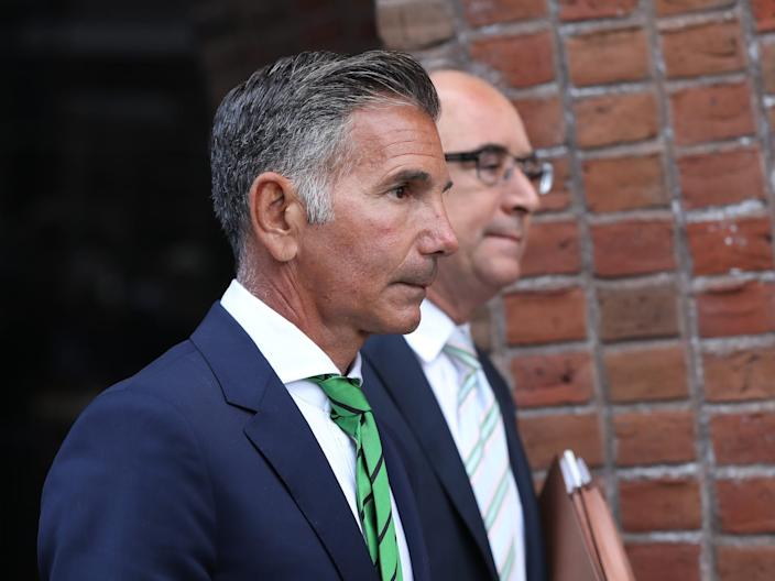 Mossimo Giannulli, left, husband of actress Lori Loughlin, follows her out of the John Joseph Moakley United States Courthouse in Boston on April 3, 2019.