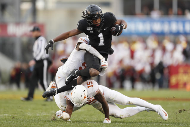 Iowa State wide receiver Tarique Milton (1) is tackled by Texas defenders D'Shawn Jamison, left, and Chris Brown after catching a pass during the first half of an NCAA college football game, Saturday, Nov. 16, 2019, in Ames, Iowa. (AP Photo/Charlie Neibergall)