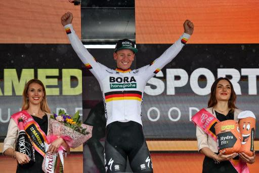 Germany's Pascal Ackermann celebrates on the podium after winning the fifth stage of the Giro D'Italia, tour of Italy cycling race, from Frascati to Terracina, Wednesday, May 15, 2019. Pascal Ackermann of Germany sprinted to victory at the end of the rain-affected fifth stage of the Giro d'Italia as Slovenian cyclist Primoz Roglic remained overall leader. (Alessandro Di Meo/ANSA via AP)