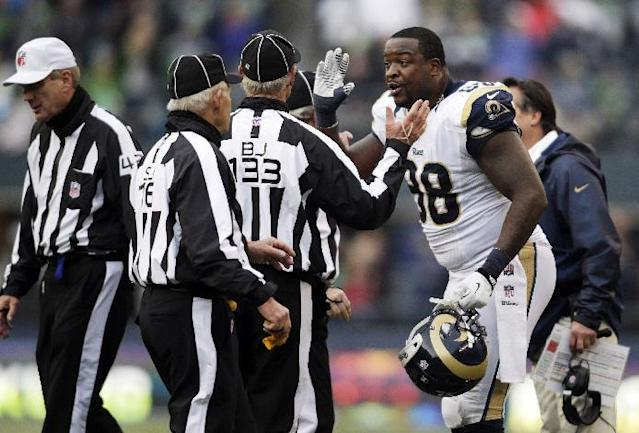 St. Louis Rams defensive tackle Kendall Langford (98) argues with back judge Steve Freeman (133) after Langford was ejected from the second half of an NFL football game against the Seattle Seahawks for unsportsmanlike conduct, Sunday, Dec. 29, 2013, in Seattle. (AP Photo/John Froschauer)