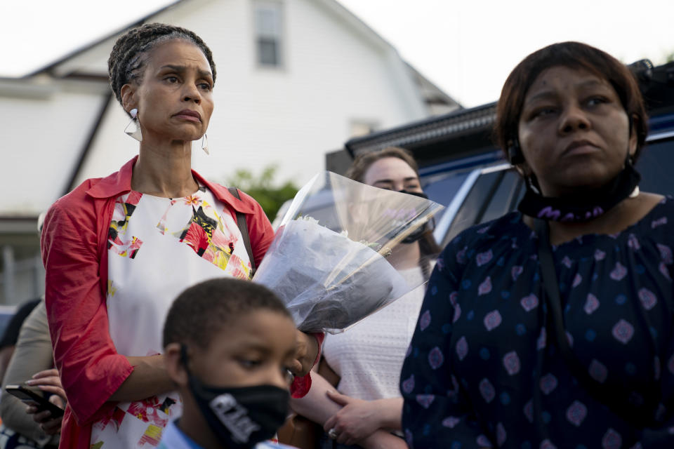 New York City mayoral candidate Maya Wiley attends a vigil at the scene where 10-year old Justin Wallace was shot and killed the previous Saturday night in the Rockaway section of the Queens borough of New York, Wednesday, June 9, 2021. The Democratic primary race for New York City mayor is nearing the finish line with a surge in shootings pushing public safety to the top of some voters' concerns.(AP Photo/John Minchillo)