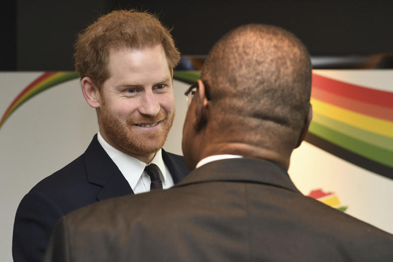 Britain's Prince Harry meets with President of Malawi, Arthur Peter Mutharika, right, at the UK Africa Investment Summit in London, Monday Jan. 20, 2020. Britain's Prime Minister Boris Johnson is hosting 54 African heads of state or government in London, as the U.K. prepares for post-Brexit dealings with the world. (Stefan Rousseau/Pool via AP)