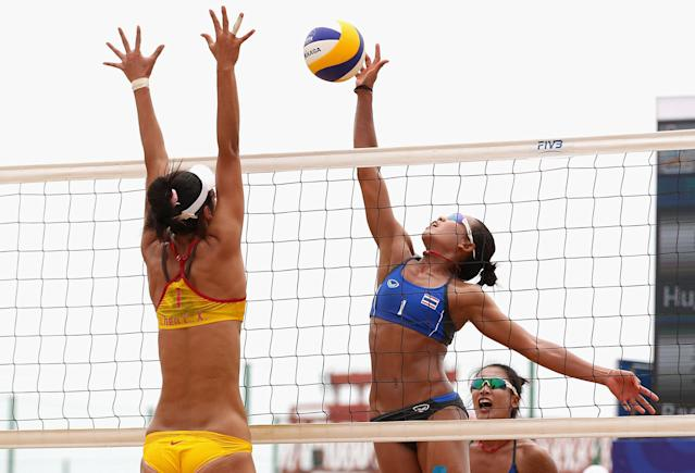 HAIYANG, CHINA - JUNE 18: Varapatsorn Radarong of Thailand spikes against Chunxia Chen of China during their Beach Volleyball Women's Gold Medal match with Tanarattha Udomchavee of Thailand and Anna Hu of China on Day 2 of the 3rd Asian Beach Games Haiyang 2012 at Fengxiang Beach on June 18, 2012 in Haiyang, China. (Photo by Ryan Pierse/Getty Images)