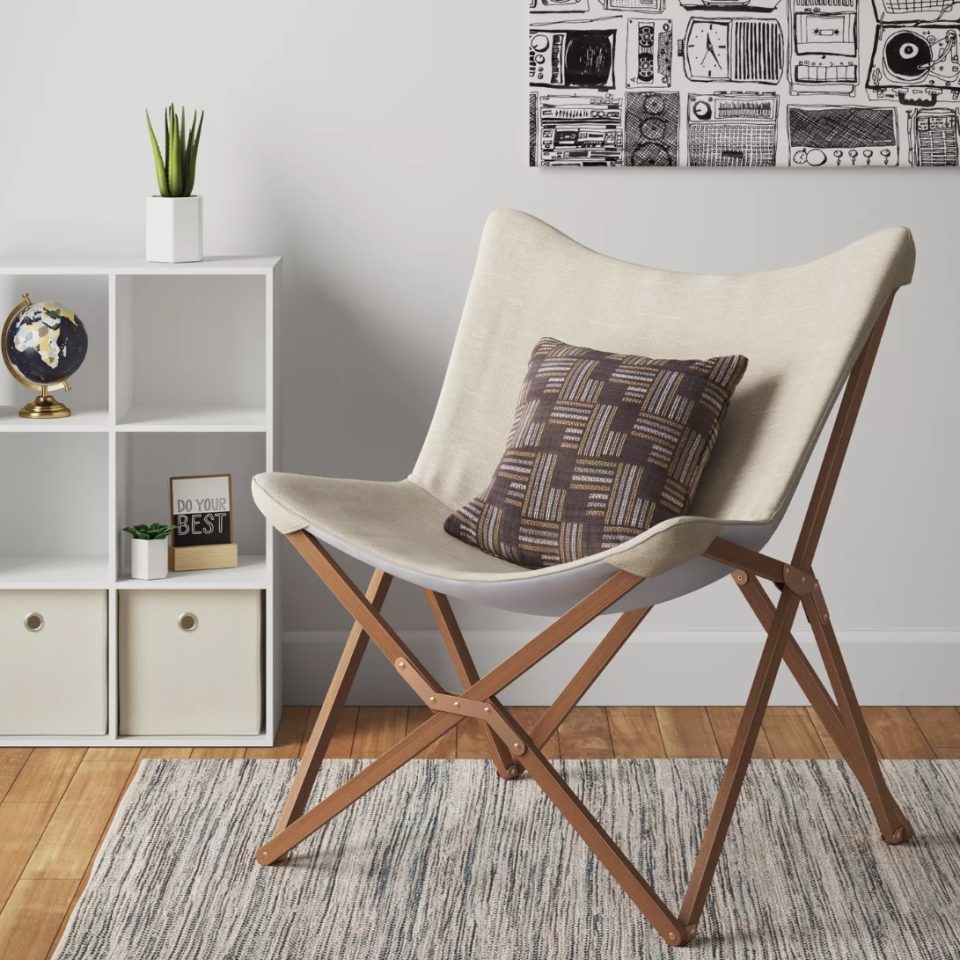 """<h3><a href=""""https://www.target.com/p/wood-butterfly-chair-room-essentials/-/A-76536271?preselect=53115048#lnk=sametab"""" rel=""""nofollow noopener"""" target=""""_blank"""" data-ylk=""""slk:Room Essentials Wooden Butterfly Chair"""" class=""""link rapid-noclick-resp"""">Room Essentials Wooden Butterfly Chair</a></h3><br><br>Maybe that plush wingback reading chair won't fly with your dorm or short-term apartment, but this elegant foldable one made from beech wood and linen certainly will.<br><br><strong>Room Essentials</strong> Wood Butterfly Chair, $, available at <a href=""""https://www.target.com/p/wood-butterfly-chair-room-essentials/-/A-76536271"""" rel=""""nofollow noopener"""" target=""""_blank"""" data-ylk=""""slk:Target"""" class=""""link rapid-noclick-resp"""">Target</a>"""