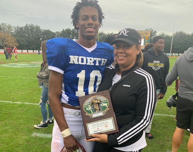 Willie Taggart Jr. and Taneshia Taggart pose for a photo after the North-South All Star game on Saturday. Willie Jr. won the North MVP award in the game. (Photo credit: Taggart family)