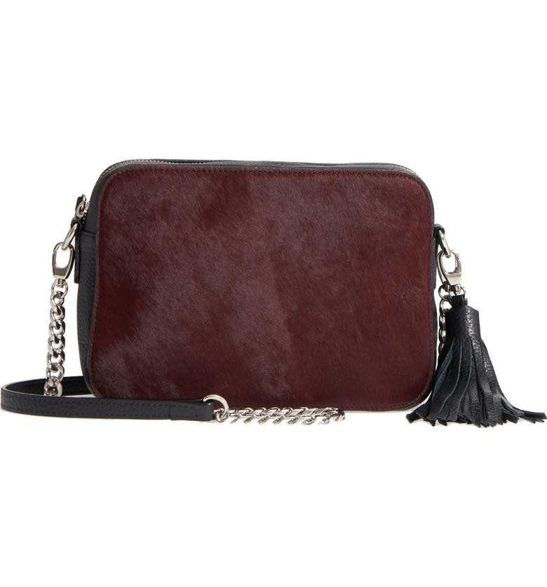 "40% off from $99. Get it <a href=""https://shop.nordstrom.com/s/nordstrom-ella-leather-genuine-calf-hair-crossbody-bag/4816582?origin=category-personalizedsort&fashioncolor=BURGUNDY%20LONDON"" target=""_blank"">here</a>."