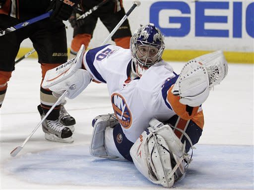 New York Islanders goalie Evgeni Nabokov, of Kazakhstan, stops a shot during the second period of an NHL hockey game against the Anaheim Ducks in Anaheim, Calif., Friday, Jan. 6, 2012. (AP Photo/Jae C. Hong)