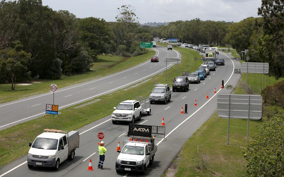Long queue of motorists who are entering Queensland from New South Wales through the border checkpoint. Queensland has closed its border to greater Sydney residents as a cluster of Covid-19 cases continues to increase. Queensland residents returning from Sydney have until 1am on Tuesday get home. - Regi Varghese/Getty Images
