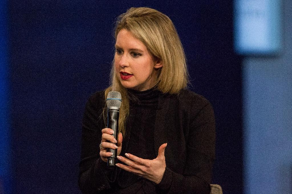 Theranos founder Elizabeth Holmes, a onetime Silicon Valley star who claimed to have developed a revolutionary blood-testing process, was charged with criminal fraud (AFP Photo/Andrew Burton)