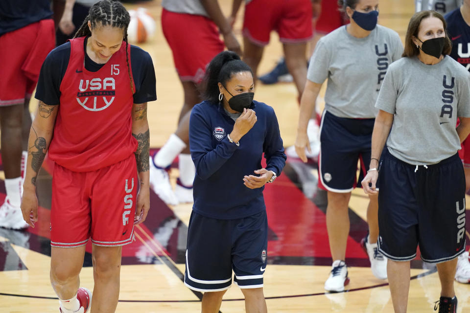 FILE - In this July 13, 2021, file photo, head coach Dawn Staley, center, coaches during practice for the United States women's basketball team in preparation for the Olympics in Las Vegas. Jennifer Gillom says everything is a process. Dawn Staley becoming the first Black female head coach of the U.S. women's Olympic basketball team is no different. (AP Photo/John Locher, File)