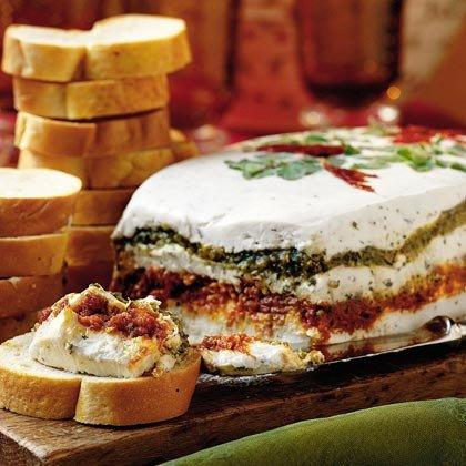"""<p>Layer pesto, sun-dried tomato, and a mixture of goat cheese and cream cheese for an impressive appetizer with Mediterranean flavors. Serve with French bread slices or crackers. </p><p><a href=""""https://www.myrecipes.com/recipe/goat-cheese-spread-0"""">Goat Cheese Spread Recipe</a></p>"""