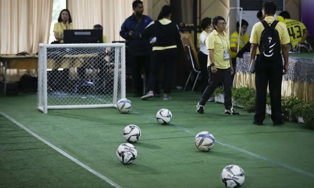 A mini football pitch had been set up at the press conference.