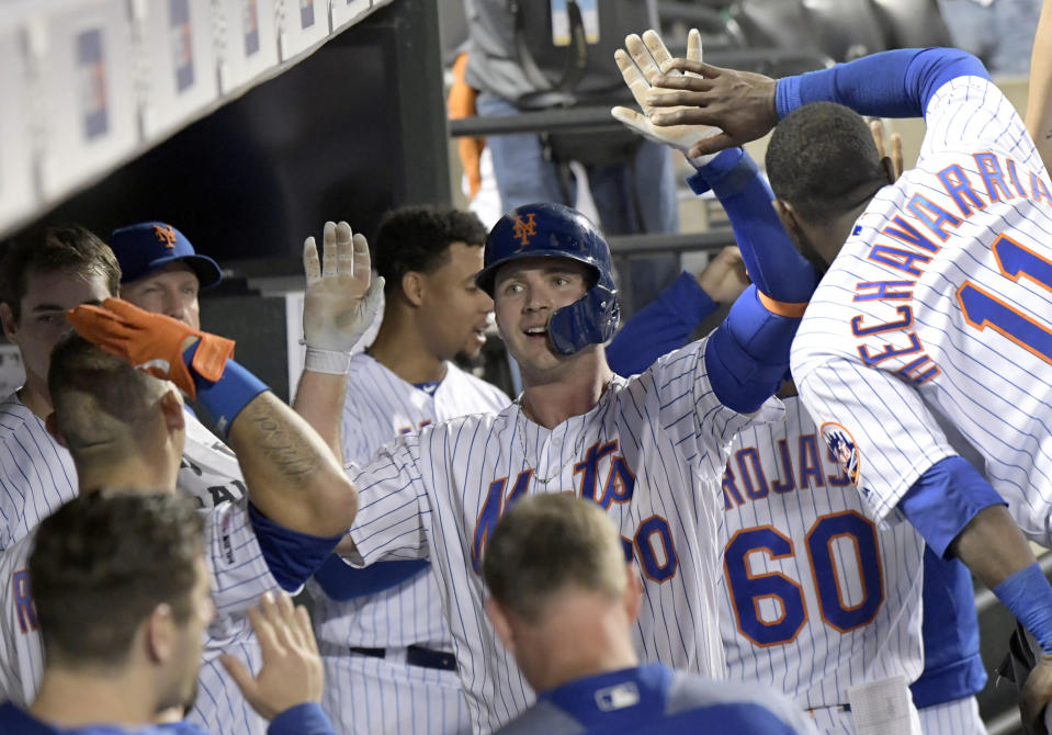 New York Mets' Pete Alonso, center, celebrates with teammates after hitting a home run during the seventh inning of a baseball game against the Colorado Rockies, Saturday, June 8, 2019, in New York. (AP Photo/Bill Kostroun)