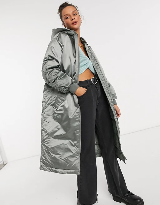 "<br><br><strong>ASOS DESIGN</strong> Longline Oversized Hooded Puffer Coat, $, available at <a href=""https://go.skimresources.com/?id=30283X879131&url=https%3A%2F%2Fwww.asos.com%2Fus%2Fasos-design%2Fasos-design-longline-oversized-hooded-puffer-coat-in-sage%2Fprd%2F20717315"" rel=""nofollow noopener"" target=""_blank"" data-ylk=""slk:ASOS"" class=""link rapid-noclick-resp"">ASOS</a>"