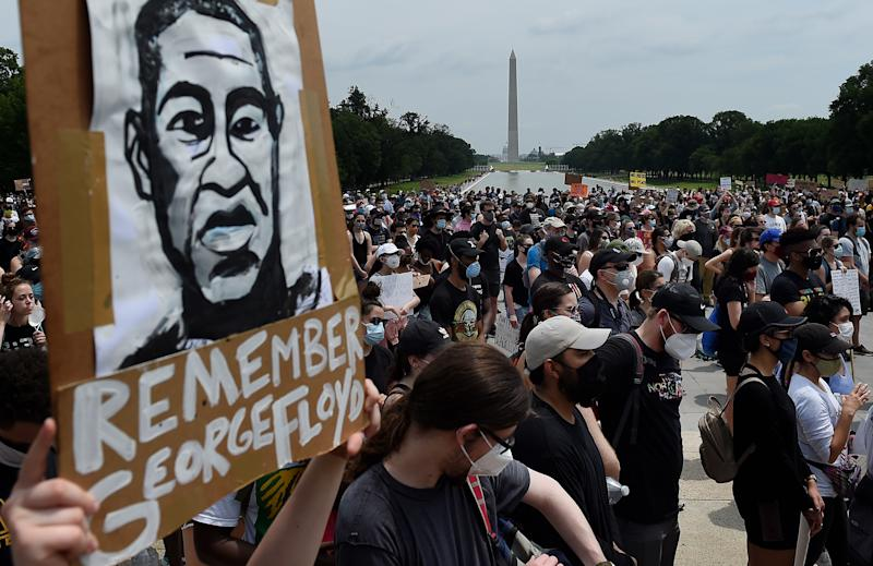 Demonstrators hold placards at the Lincoln Memorial during a peaceful protest against police brutality and the death of George Floyd, on June 6, 2020 in Washington, DC. - Demonstrations are being held across the US following the death of George Floyd on May 25, 2020, while being arrested in Minneapolis, Minnesota. (Photo by Olivier DOULIERY / AFP) (Photo by OLIVIER DOULIERY/AFP via Getty Images)