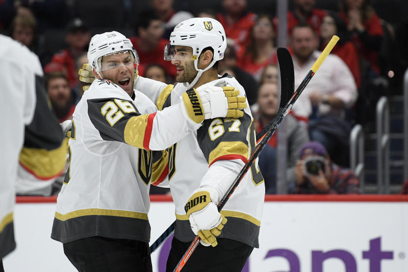 Vegas Golden Knights left wing Max Pacioretty (67) celebrates his goal with center Paul Stastny (26) during the first period of an NHL hockey game against the Washington Capitals, Saturday, Nov. 9, 2019, in Washington. (AP Photo/Nick Wass)