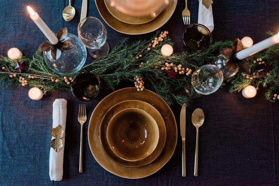 """<p>For evening festivities, an inky color palette adds an instant dose of luxury and helps other accent colors stand out.</p><p><a class=""""link rapid-noclick-resp"""" href=""""https://go.redirectingat.com?id=74968X1596630&url=https%3A%2F%2Fwww.williams-sonoma.com%2Fproducts%2Fwashed-linen-tablecloth&sref=https%3A%2F%2Fwww.townandcountrymag.com%2Fleisure%2Fg13616373%2Fthanksgiving-table-setting-decor-ideas%2F"""" rel=""""nofollow noopener"""" target=""""_blank"""" data-ylk=""""slk:SHOP NOW"""">SHOP NOW</a> <em>Italian Washed Linen Tablecloth, $149.95 </em></p>"""