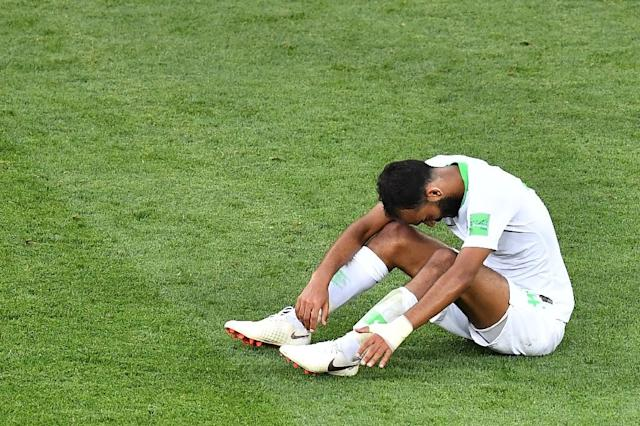 Saudi Arabia midfielder Abdullah Otayf reflects after his side were eliminated by Uruguay (AFP Photo/JOE KLAMAR)