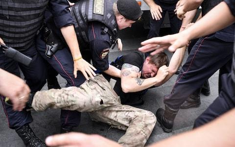 Police arrest a man at the protest inspired by the case against journalist Ivan Golunov - Credit: Alexander Nemenov/AFP