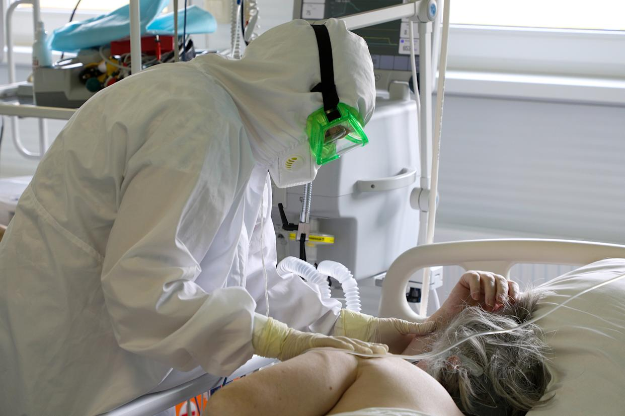 A healthcare worker and a patient in an intensive care unit at the Kalachevskaya Central District Hospital treating people who suffer from the novel coronavirus disease.