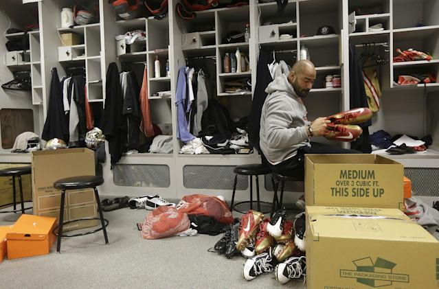 San Francisco 49ers linebacker Michael Wilhoite packs belongings from his locker at an NFL training facility in Santa Clara, Calif., Monday, Jan. 20, 2014. The 49ers lost to the Seattle Seahawks in the NFC Championship Game. (AP Photo/Jeff Chiu)