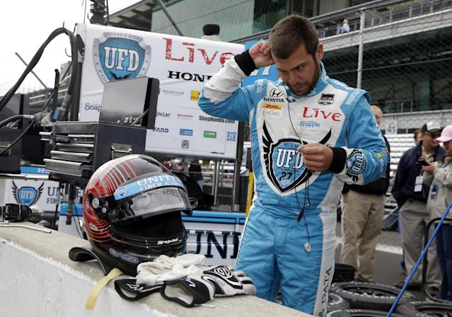 E. J. Viso, of Venezuela, prepares to drive during practice for the Indianapolis 500 IndyCar auto race at the Indianapolis Motor Speedway in Indianapolis, Thursday, May 15, 2014. (AP Photo/Michael Conroy)